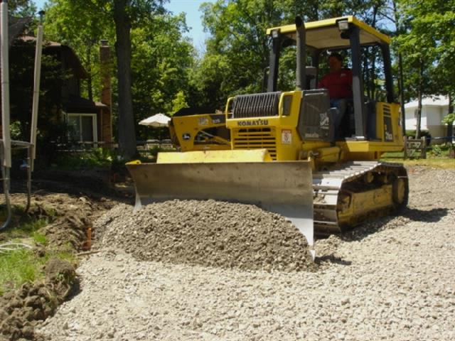 Leveling the Gravel -Asphalt Paving